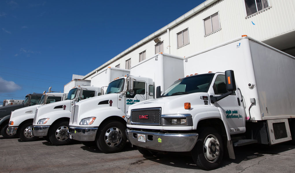 Pictured above, Eight Point Distributor's company fleet of delivery trucks parked in front of its 24,000 sqft freezer facility.